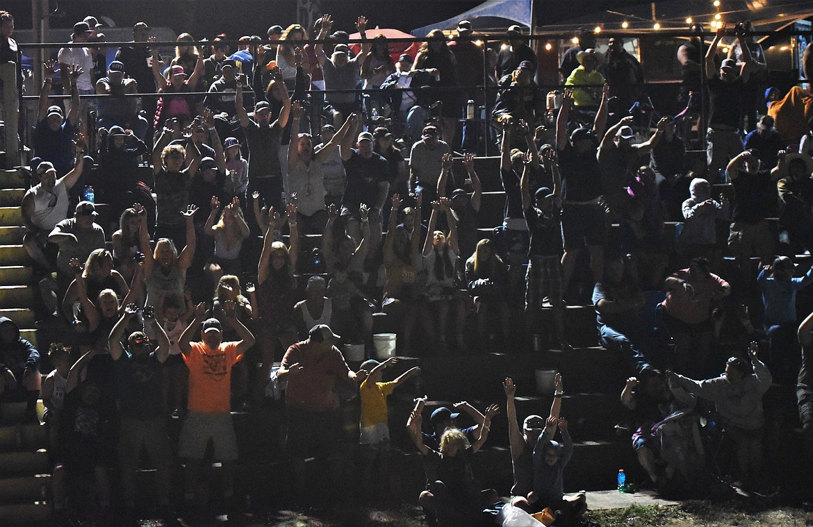 The crowd at Mission Valley Super Oval got the wave going near the end of the Montana 200. (Scot Heisel/Lake County Leader)