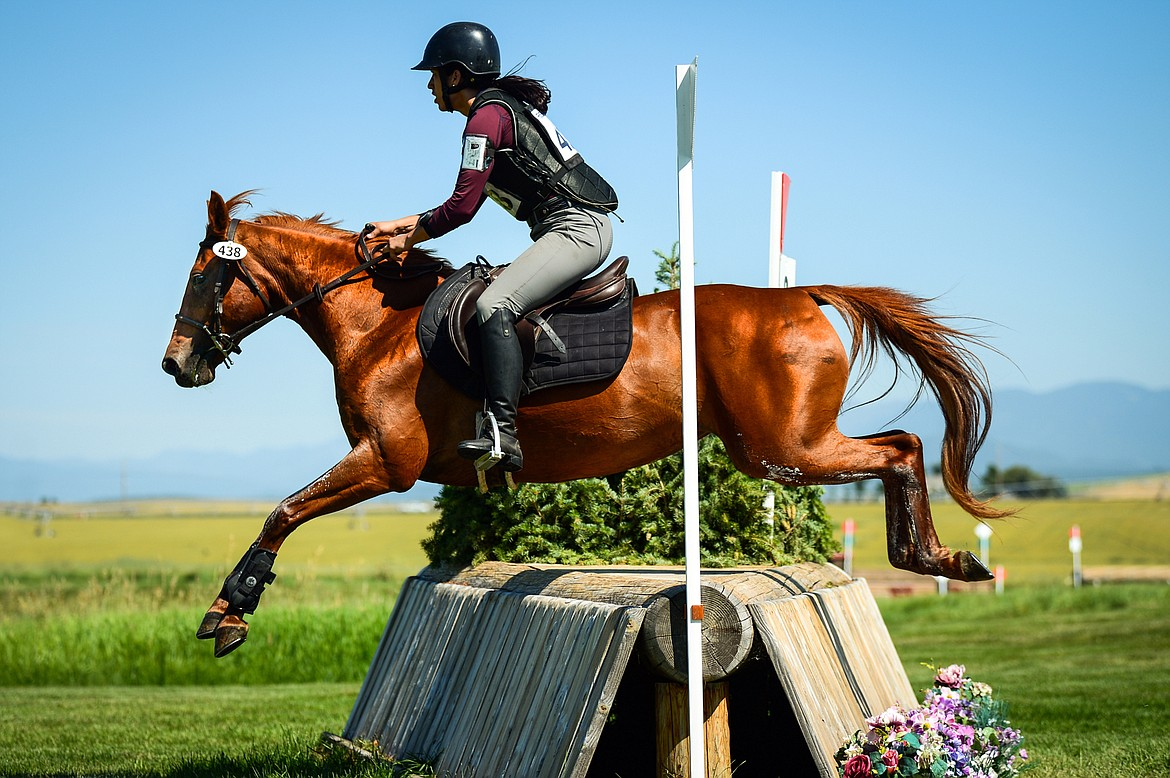 Heather Schiedermayer and Wildfire clear a jump during Senior Open Novice D cross-country at The Event at Rebecca Farm on Thursday, July 22. (Casey Kreider/Daily Inter Lake)