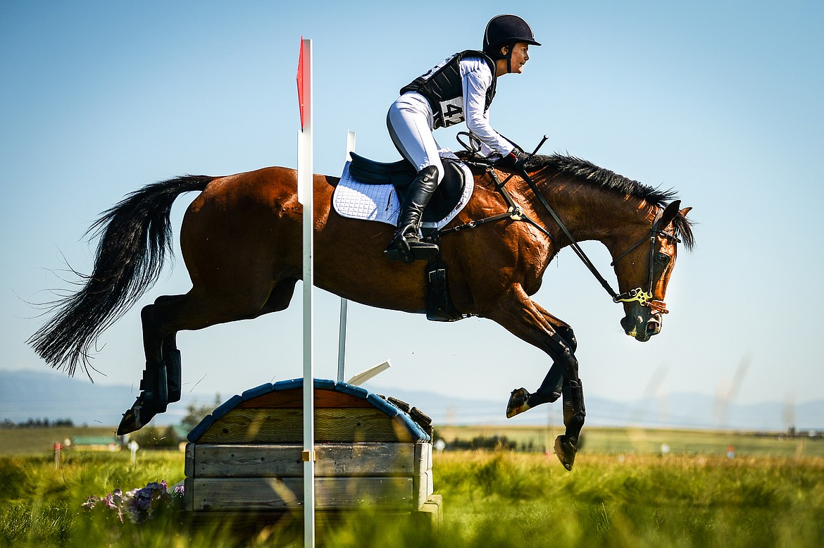 Lorane Matarazzo and Darentogo clear a jump during Senior Open Novice D cross-country at The Event at Rebecca Farm on Thursday, July 22. (Casey Kreider/Daily Inter Lake)