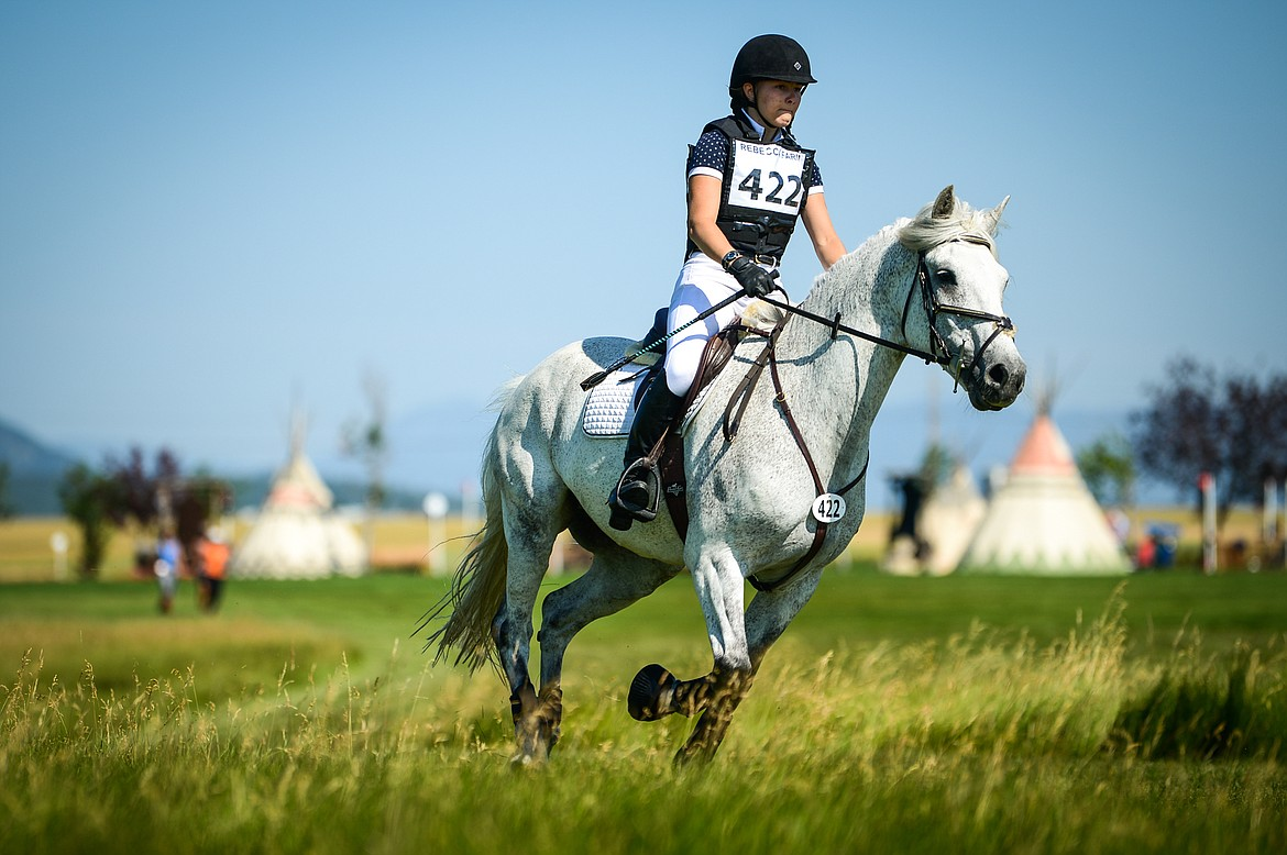Chiara Heimbeck rides Grady through the Senior Open Novice D cross-country course at The Event at Rebecca Farm on Thursday, July 22. (Casey Kreider/Daily Inter Lake)