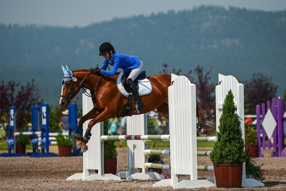 Lois James rides Copper Fox durng Senior Open Novice D Show Jumping at The Event at Rebecca Farm on Friday, July 23. (Casey Kreider/Daily Inter Lake)