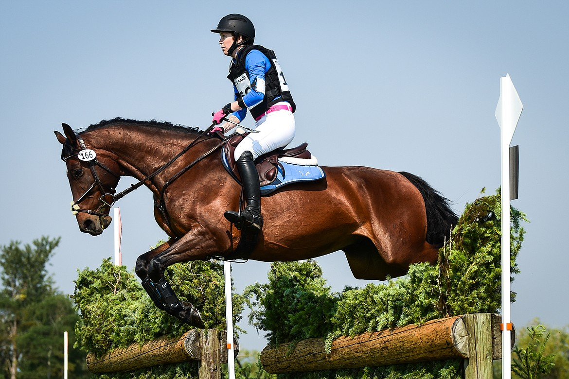 Rose Lemke and Watch Maker C clear a jump in the Training Three-Day cross-country course at The Event at Rebecca Farm on Friday, July 23. (Casey Kreider/Daily Inter Lake)