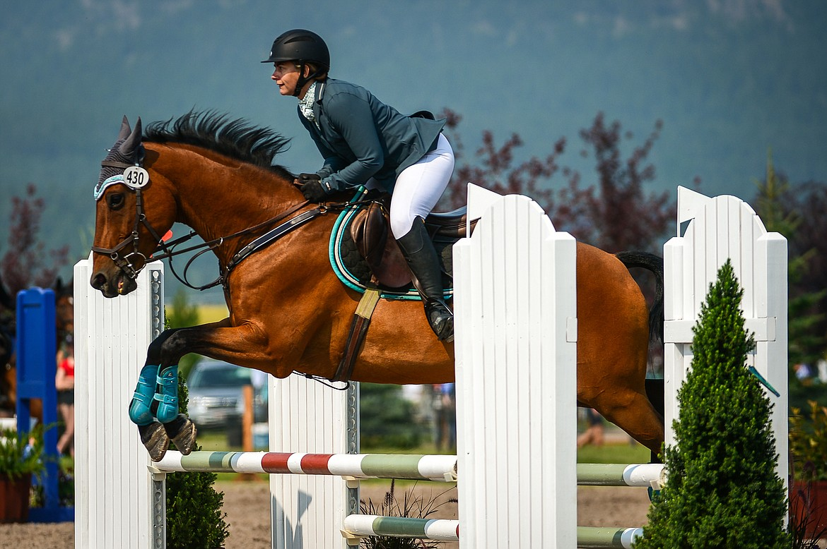 Jodie Corless rides Eloquent during Senior Open Novice D Show Jumping at The Event at Rebecca Farm on Friday, July 23. (Casey Kreider/Daily Inter Lake)