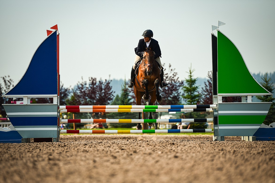 Tiare Santistevan rides L'Orange during Senior Open Novice D Show Jumping at The Event at Rebecca Farm on Friday, July 23. (Casey Kreider/Daily Inter Lake)