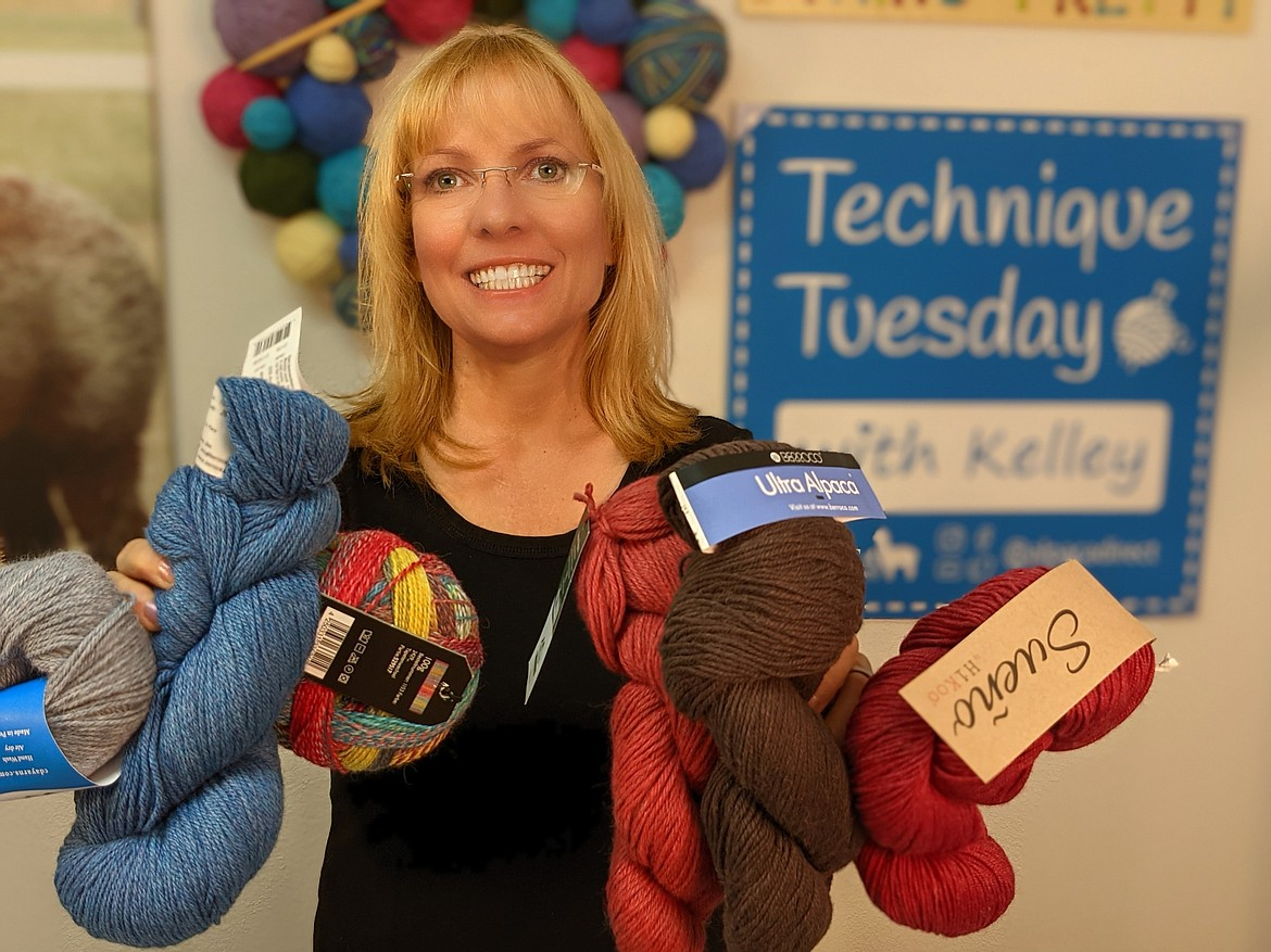 Courtesy photo Owner Kelly Hobart holds some of the products available at Alpaca Direct and Croc Coatings, which has moved to 4290 W. Riverbend Ave. in Post Falls.
