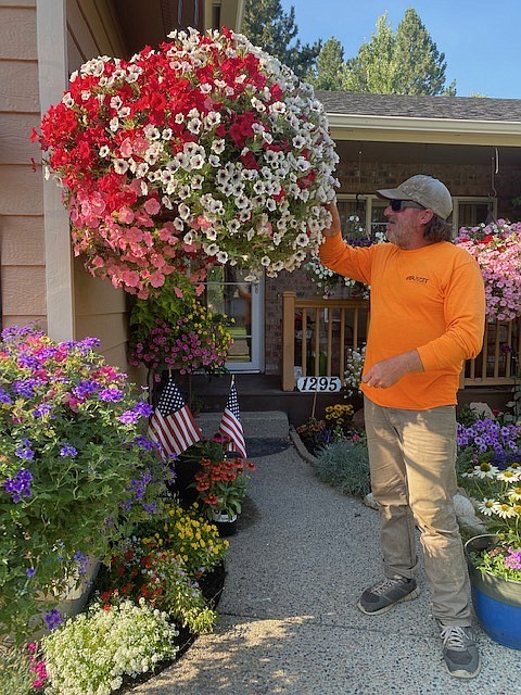 Duff Angle, a construction worker picked up gardening three years ago; being colorblind hasn't kept him from creating eye-catching displays of beautifully shaded blooms; tending his garden daily, he spends about 12 hours on it every week