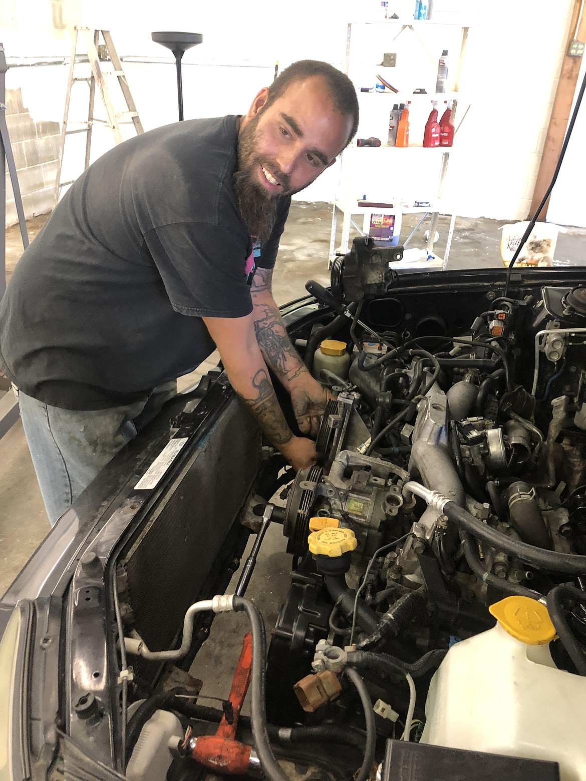 Courtesy photo Michael Russo works on a vehicle at Subee's auto repair and classic restoration at 1400 Best Ave. in Coeur d'Alene.