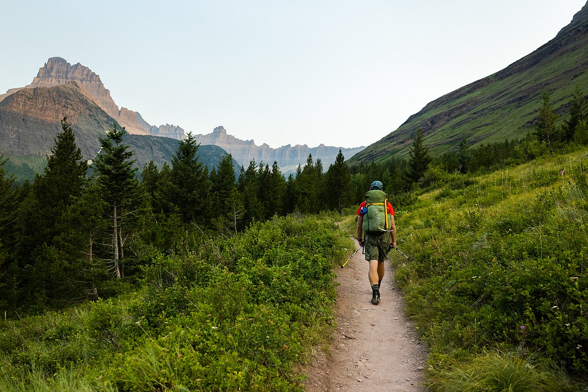 Greg Burfeind walks up a trail toward Ptarmigan Pass on the way to Mount Merritt in Glacier National Park after a rejuvenating night's sleep at the Many Glacier Hotel. (Courtesy of Noah Couser)