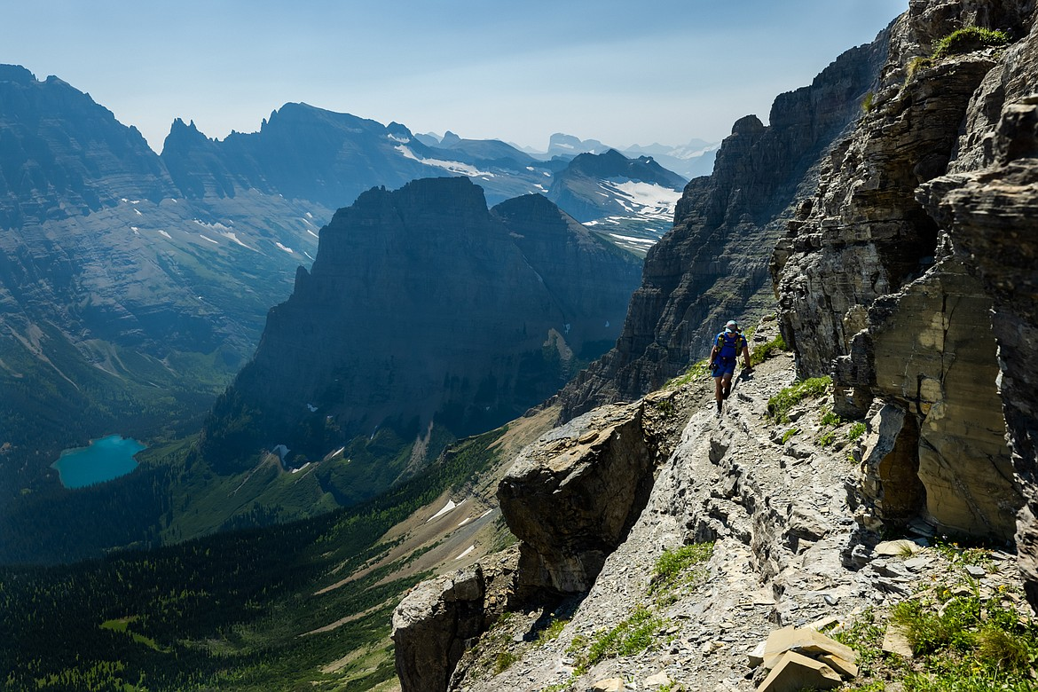 Greg Burfeind hikes along a goat trail on the eastern face of Mount Cleveland, moments before he and Noah Couser decided to turn back during an attempt to climb the six highest peaks in Glacier National Park in six days. (Courtesy of Noah Couser)