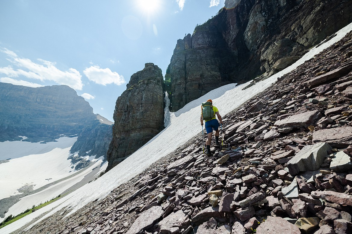 Greg Burfeind surveys a chimney half-filled with snow required to access Almost-a-Dog Pass in Glacier National Park. (Courtesy of Noah Couser)