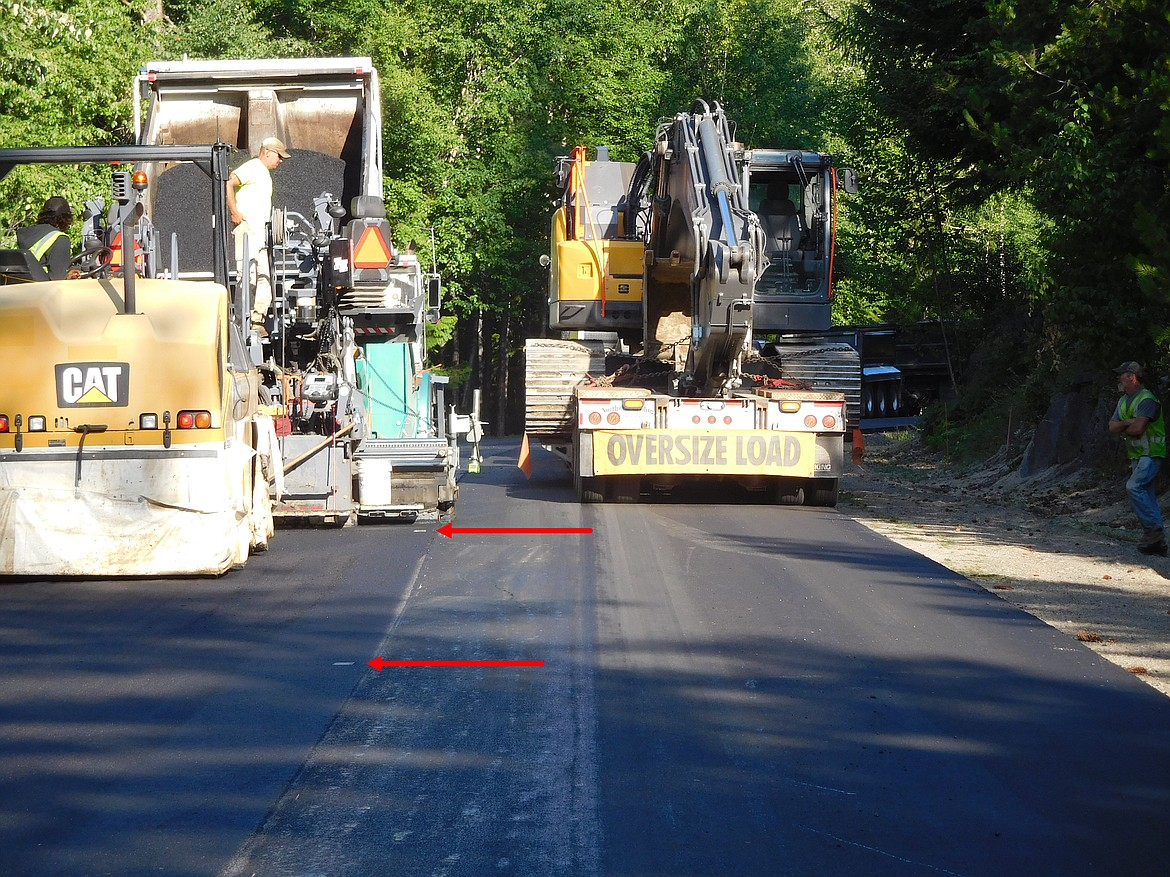 The innovative Thermoplastic markings which help identify the center line of Schweitzer Mountain Road begins during the paving process. A steamroller impresses four-by-six inch plates into the soft asphalt. The plates are removed, and then a couple days later, yellow reflective tape is melted into the divots.