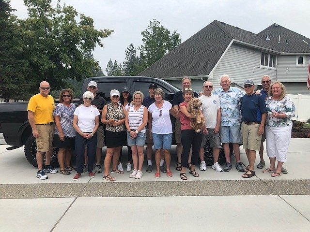 The residents of the Highlands community held their semi-annual golf cart parade and collected 996 pounds of food and $2,020 in cash for the Post Falls Food Bank. From left: Ardie Wardell, Kristi Wardell, Linda Dixon, Rick Dixon, Pat Thyssen, Kim Wright, Jodi O'Connell, Jim Thyssen, Cheryl Dickinson, Chris Kellogg, Denise McDermott, Marley the dog, Roger Dickinson, Jim Houston, Dennis McDermott, Kent Allen and Christie Allen. Not shown: Louise Burkhartsmeier.