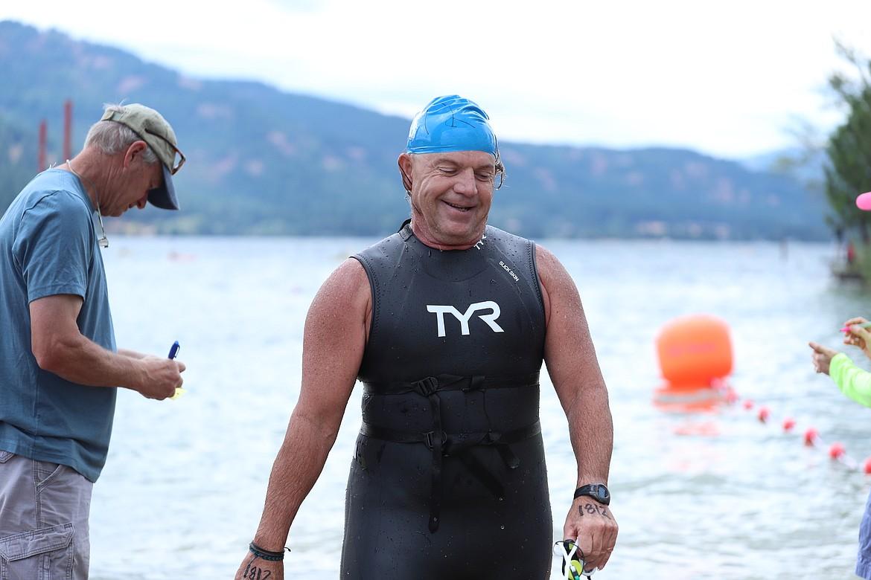 The shark (Kim Woodruff) crosses the finish line on Saturday.
