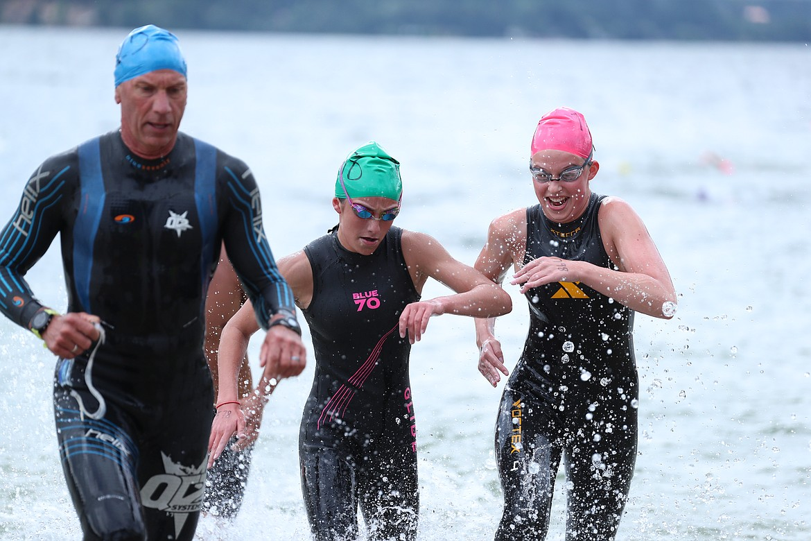 A group of swimmers battle for position as they near the end of the Long Bridge Swim on Saturday.