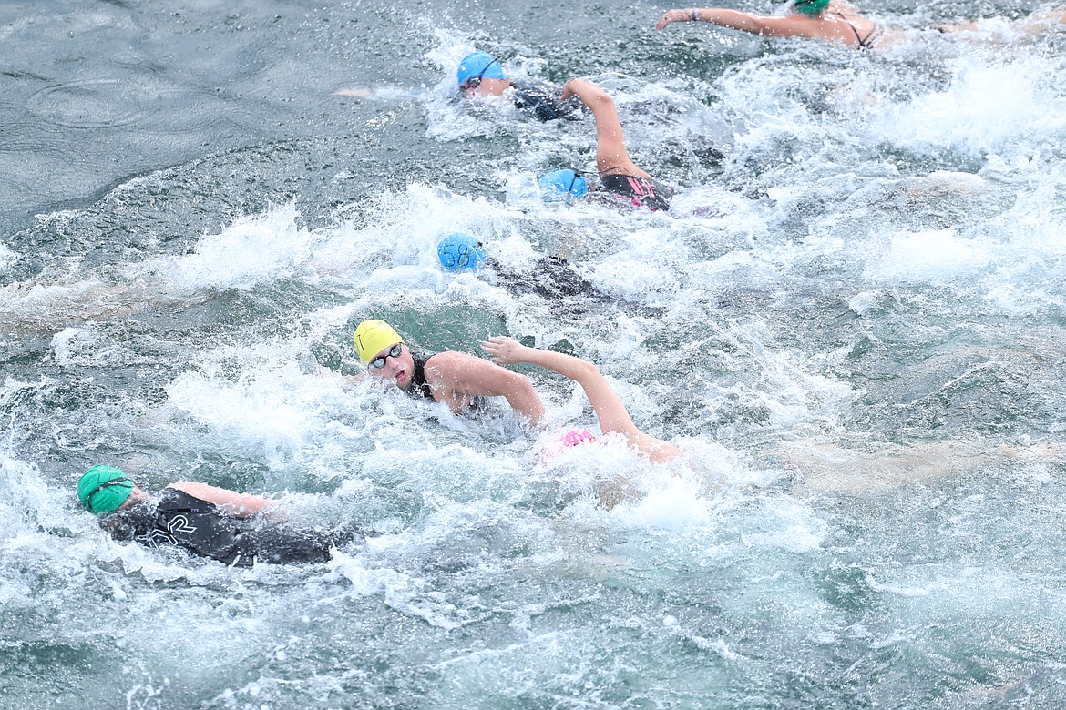 Swimmers take off from the start line on Saturday.