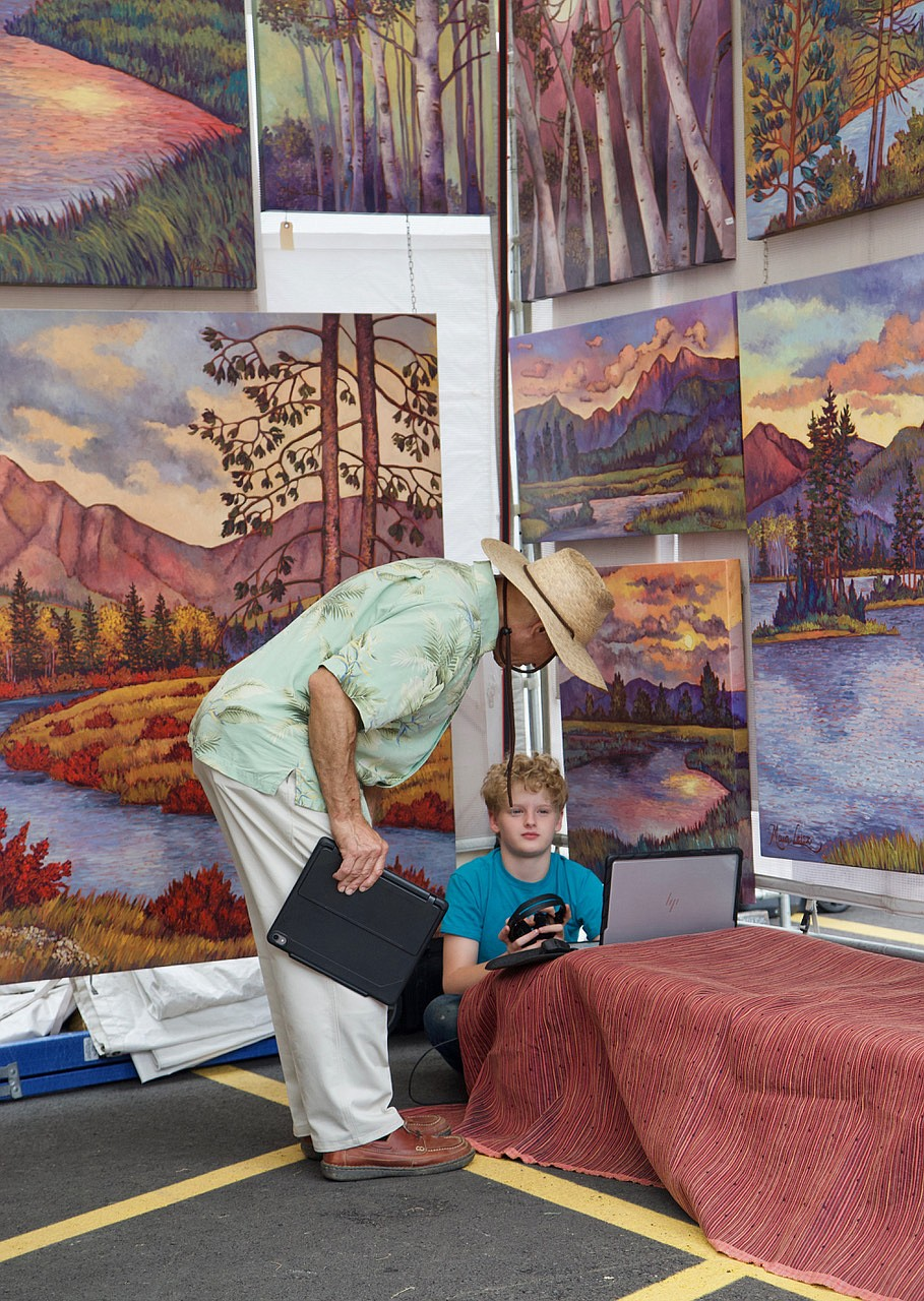 Colorful landscape paintings adorn this booth at the Bigfork Festival of the Arts. (Kay Bjork photo)