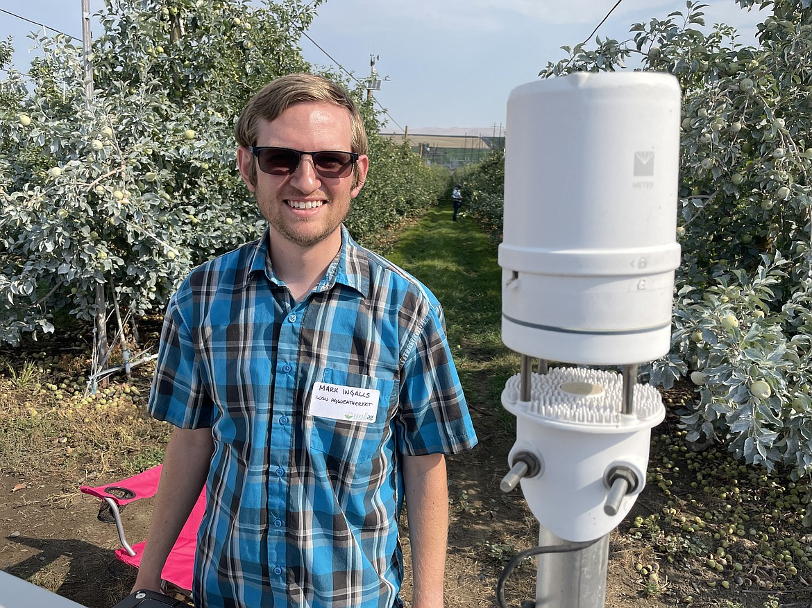 Mark Ingalls with WSU's AgWeatherNet and one of system's simple weather monitors. Ingalls said AgWeatherNet has around 50 of these stations across the region, including in parts of Oregon and Idaho.