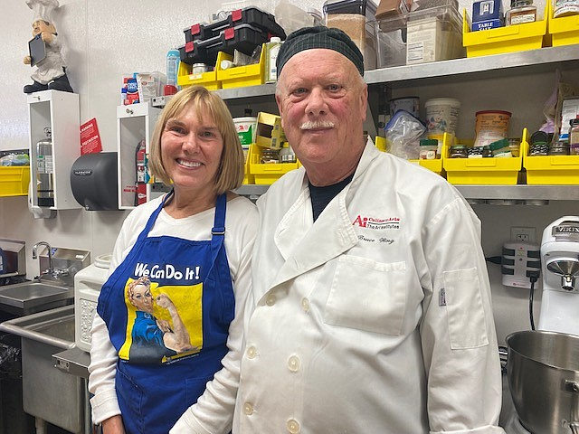 """Master baker Bruce Wing and his wife Kristen, owners of Culinaire Express in Post Falls, stand in the center of their private commercial grade kitchen. Bruce does all of the baking while Kristen said, """"I do the finances, and the dishes."""""""