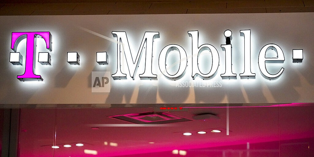 This Feb. 24, 2021 photo shows a T-Mobile store at a shopping mall in Pittsburgh. T-Mobile says about 7.8 million of its current postpaid customer accounts' information and approximately 40 million records of former or prospective customers who had previously applied for credit with the company were involved in a recent data breach. T-Mobile said Wednesday, Aug. 18, that customers' first and last names, date of birth, Social Security numbers, and driver's license/ID information were exposed. (AP Photo/Keith Srakocic)