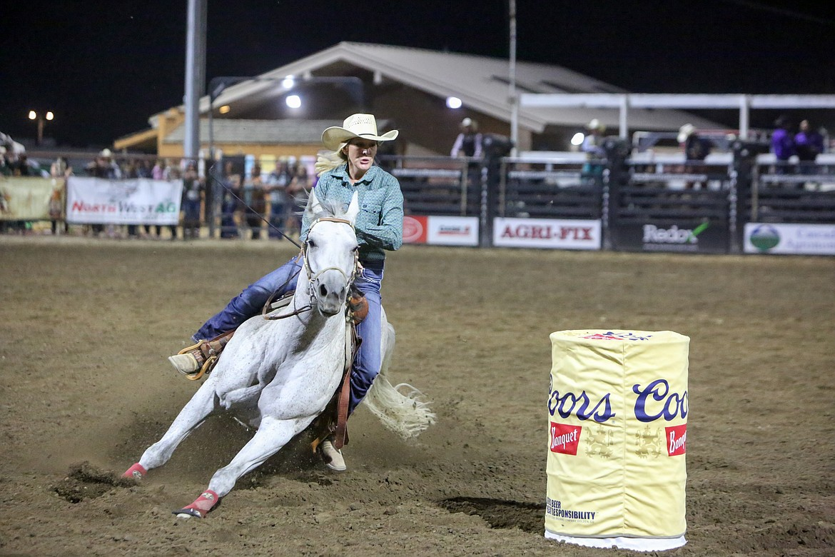 Audrey Tibbs of Moses Lake rounds the barrel during the barrel racing event on Saturday night at the Moses Lake Roundup Rodeo.