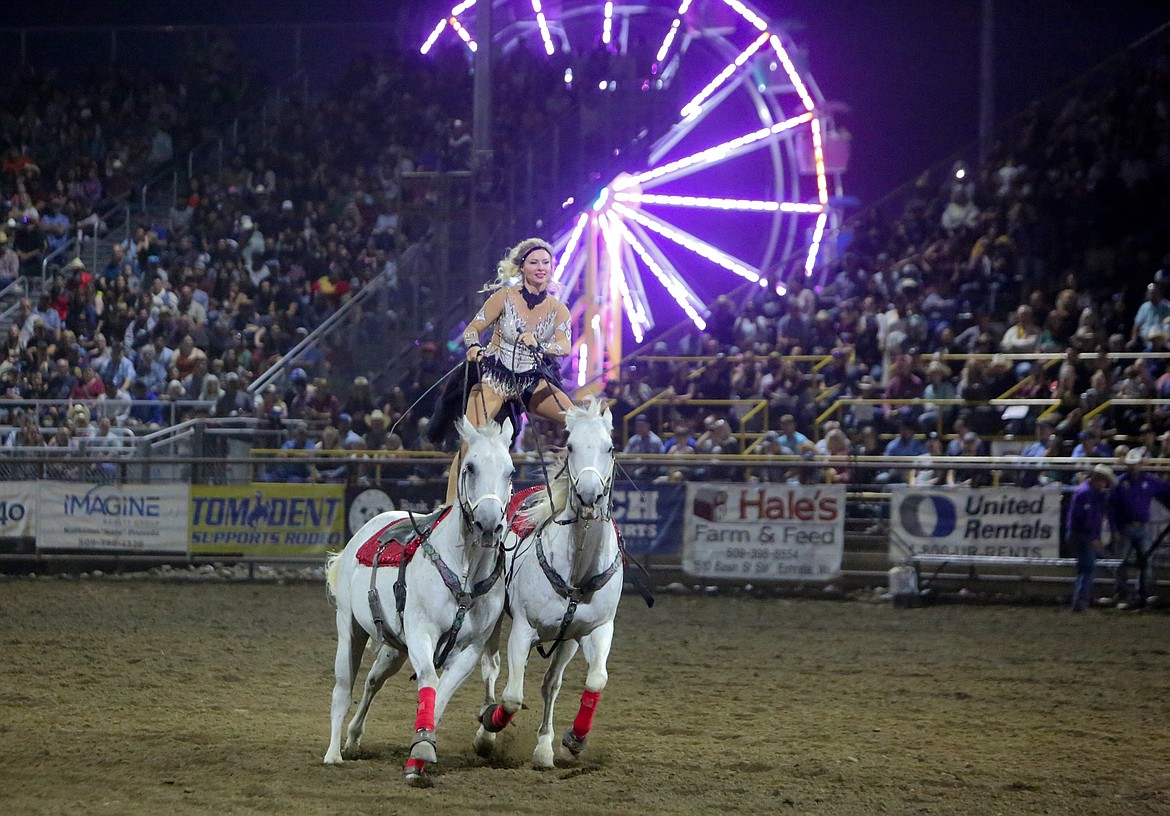 Trick rider Jessica Blair entertains the crowd at the Moses Lake Roundup Rodeo on Saturday night at the Grant County Fairgrounds.