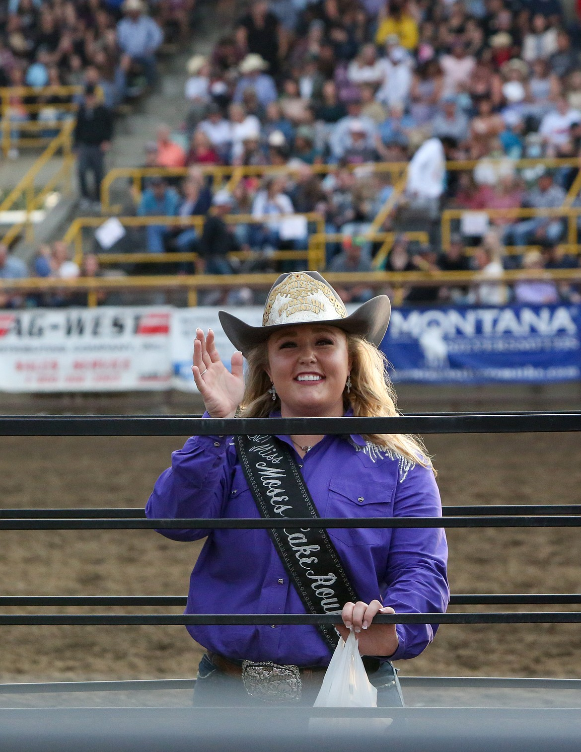 Moses Lake Roundup Queen Mykiah Hollenbeck waves to the crowd from the arena on Saturday night at the Moses Lake Roundup.