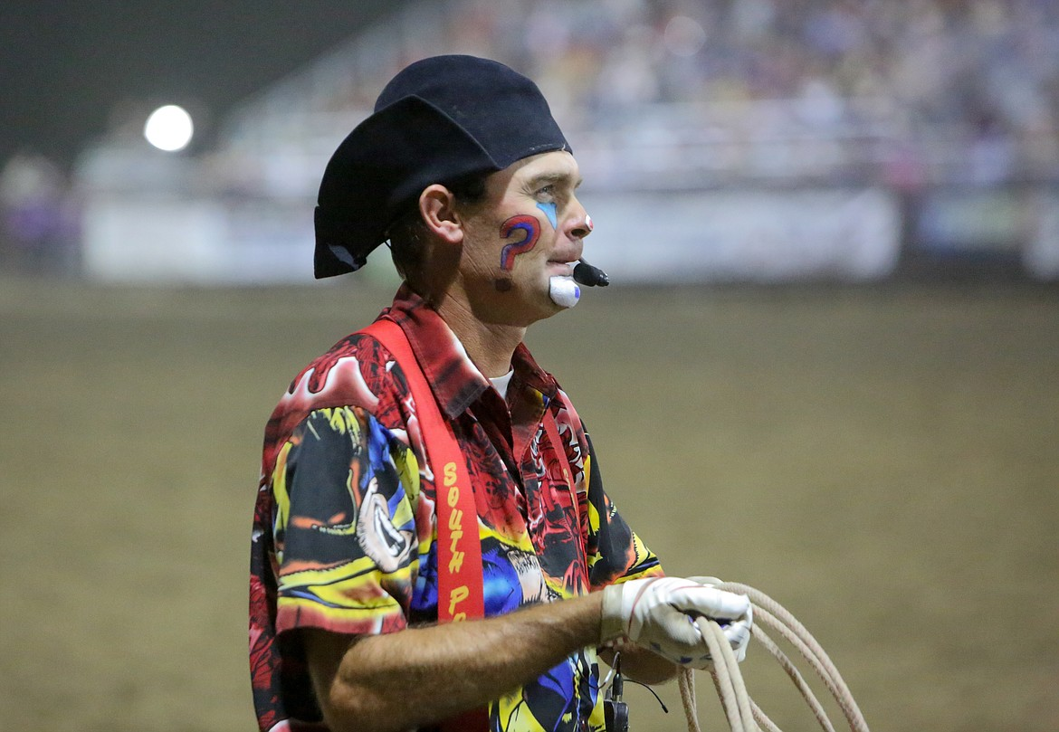 Rodeo clown J.W. Winklepleck watches competitors as he makes his way around the sidelines of the arena at the Grant County Fairgrounds on Saturday at the Moses Lake Roundup.