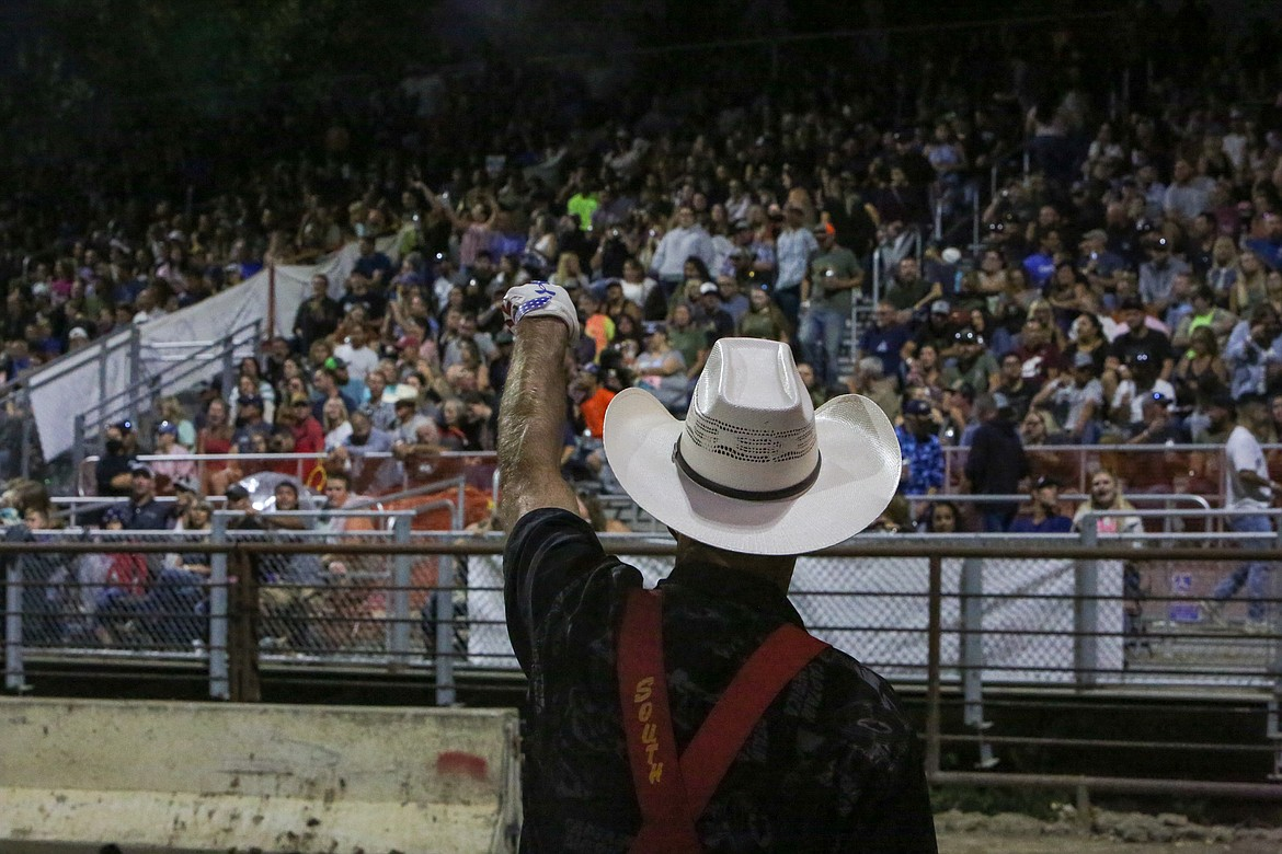 Rodeo clown J.W. Winklepleck amps up the crowd on Aug. 18 at the Northwest Ag Demolition Derby at the Grant County Fairgrounds.