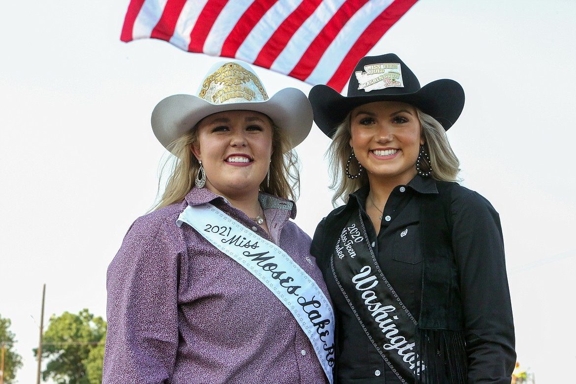 Moses Lake Roundup Queen Mykiah Hollenbeck, at left, and Miss Teen Rodeo Washington Chloe Brown pose together for a photo on Aug. 18 at the Northwest Ag Demolition Derby.