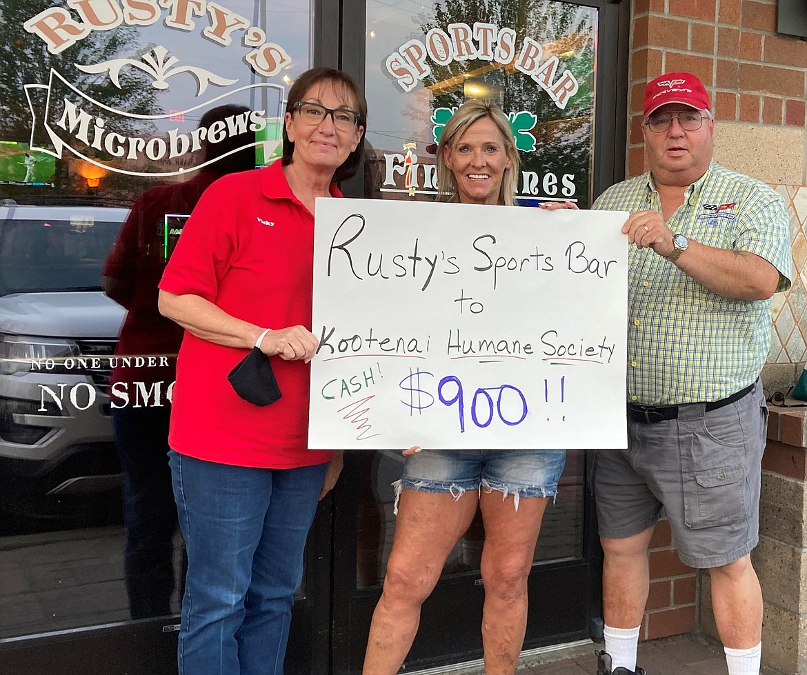 Gift of local giving   Hot August Nights Emergency Medical Supplies Fundraiser held at Rusty's Sports Bar in Hayden takes in $900 to help with medical costs at the Kootenai Humane Society's shelter. Funds will be used to purchase antibiotics, pain medication and surgery supplies for dogs and cats. From left: Vicky Nelson, development director for the Kootenai Humane Society; Kelly-Jo Arnold, general manager for Rusty's Sports Bar; and Dean Opsal, president of the North Idaho Corvette Club.