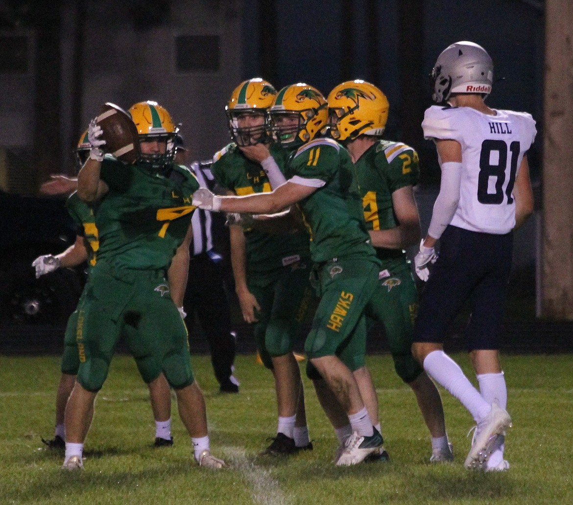 MARK NELKE/Press Lakeland's Thomas Calder (4) is congratulated after intercepting a pass against Lake City in the first half on Friday night in Rathdrum.