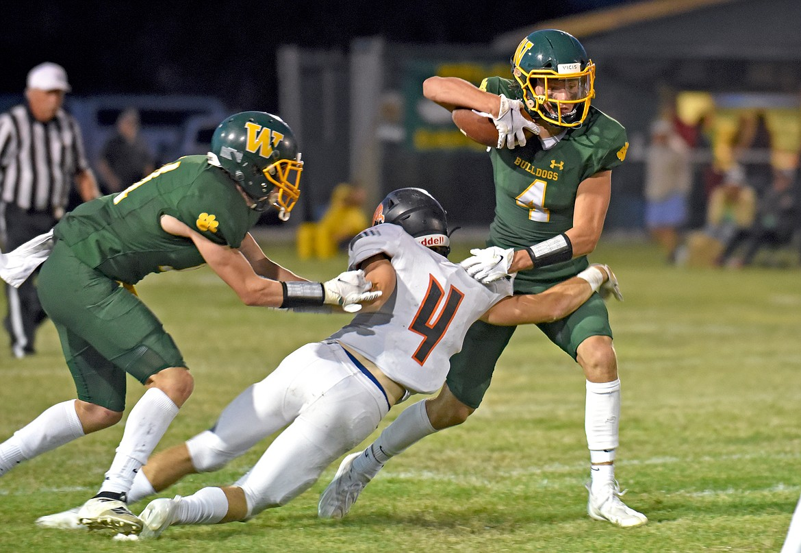 Bulldog Jaxsen Schlauch breaks through a tackle against Frenchtown in a game on Friday in Whitefish. (Whitney England/Whitefish Pilot)