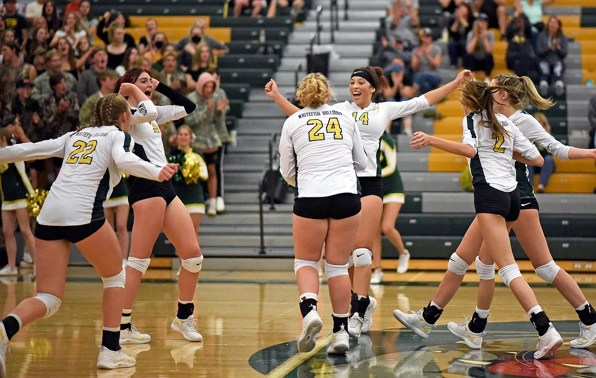 The Lady Bulldog volleyball team celebrates winning a point in a match against Frenchtown in Whitefish on Thursday. (Whitney England/Whitefish Pilot)