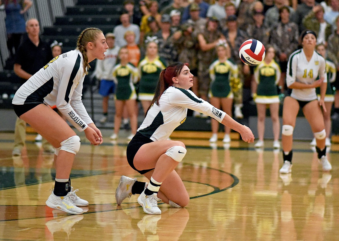 Whitefish senior Jadi Walburn kneels to receive a serve in a match against Frenchtown in Whitefish on Thursday. (Whitney England/Whitefish Pilot)