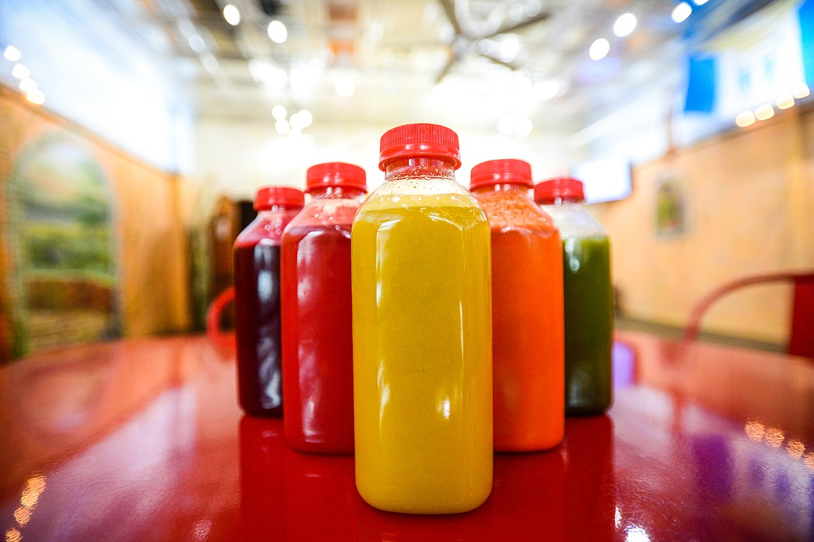 A variety of organic juices, from left, Bitter Roots, Watermelon Cooler, Organic Orange Juice, Turmeric Dream and Mean Green at Huck's Place Ginger Brew and Juice Bar in Whitefish on Wednesday, Sept. 8. (Casey Kreider/Daily Inter Lake)
