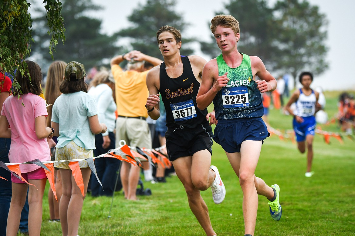 Glacier's Sam Ells leads Missoula Sentinel's Chase Green at the start of the third lap during the Flathead Invite at Rebecca Farm on Friday, Sept. 10. Ells placed first with a time of 15:53.67. (Casey Kreider/Daily Inter Lake)
