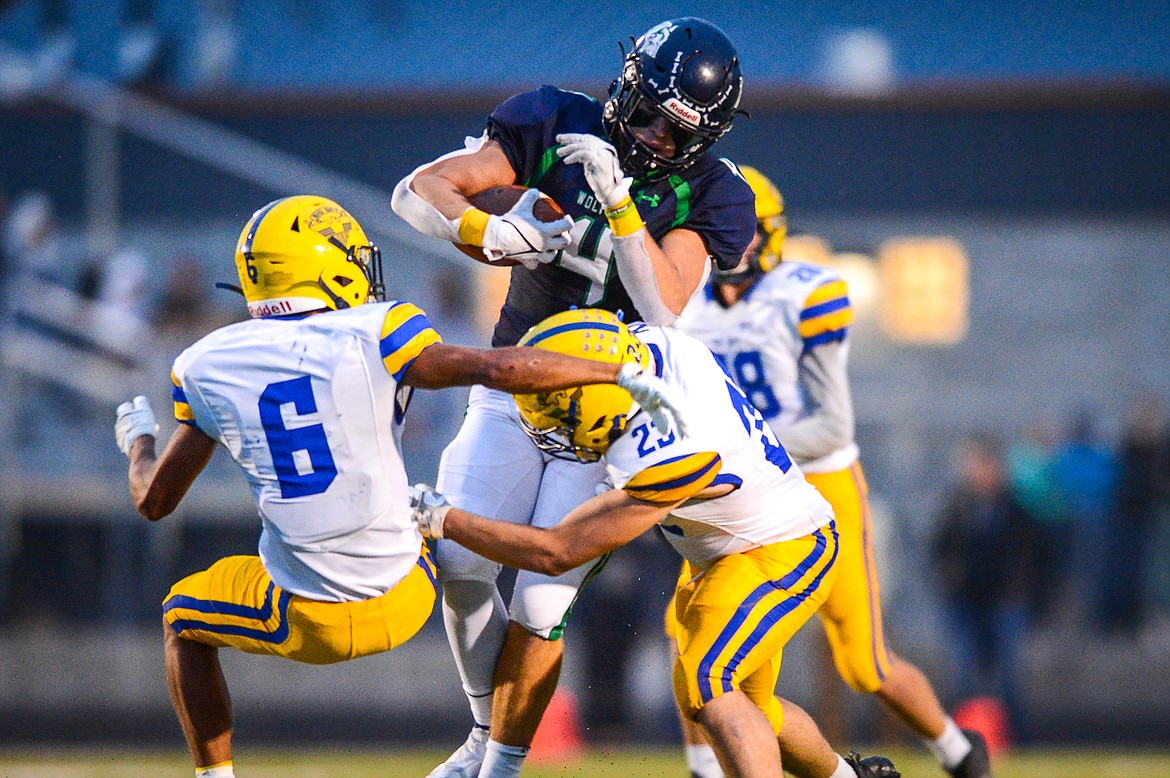 Glacier tight end Luke Bilau (4) breaks a pair of tackles by Missoula Big Sky defenders Louis Sanders (6) and Dallas Wells (23) on a second-quarter reception at Legends Stadium on Friday, Sept. 10. (Casey Kreider/Daily Inter Lake)