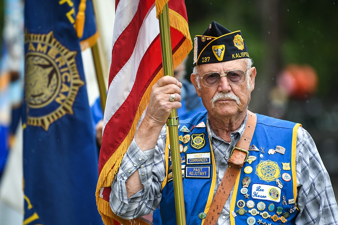 Kalispell American Legion Post 137 Finance Officer Lee Heser holds the American flag as he leads the 9/11 Freedom Walk to Depot Park for a commemorative ceremony on Saturday, Sept. 11. (Casey Kreider/Daily Inter Lake)