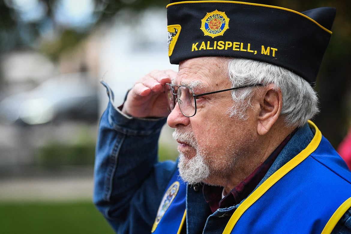 Ed Van Scoten, a retired Air Force veteran, salutes the flags displayed at Depot Park during the 9/11 Freedom Walk on Saturday, Sept. 11. (Casey Kreider/Daily Inter Lake)