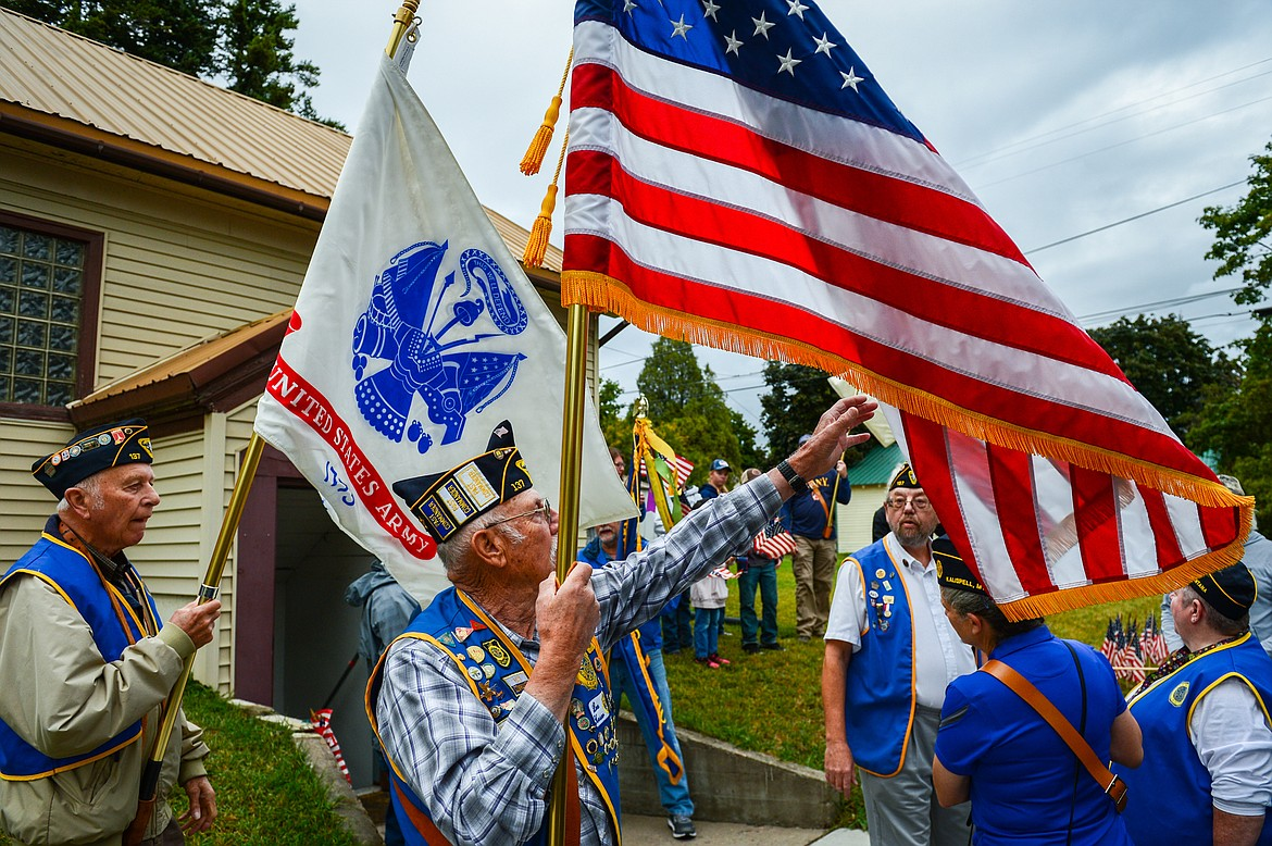 Kalispell American Legion Post 137 Finance Officer Lee Heser holds the American flag as fellow members gather before the 9/11 Freedom Walk to Depot Park for a commemorative ceremony on Saturday, Sept. 11. (Casey Kreider/Daily Inter Lake)