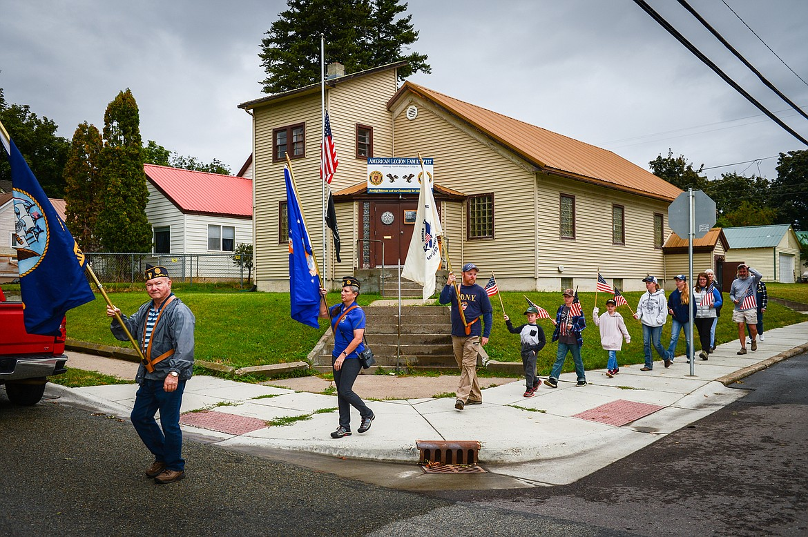 Members of the Kalispell American Legion Post 137 and the public participate in  a 9/11 Freedom Walk to Depot Park for a commemorative ceremony on Saturday, Sept. 11. (Casey Kreider/Daily Inter Lake)
