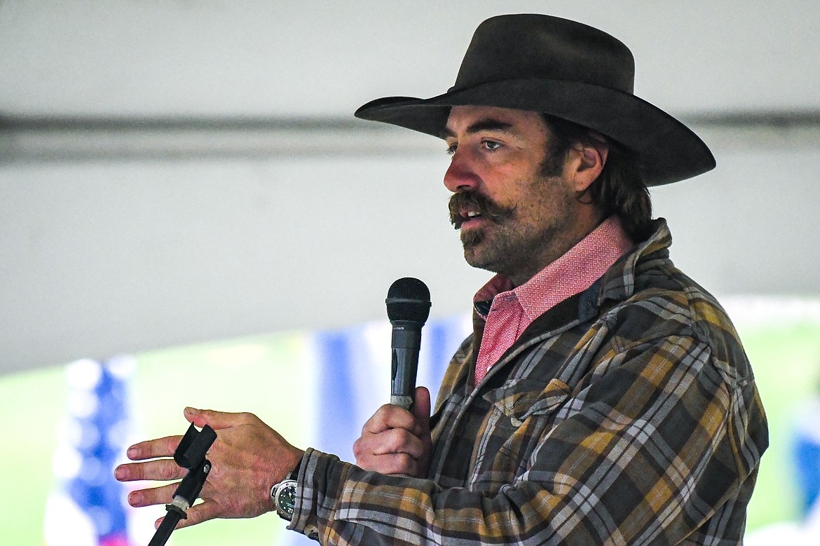 Keynote speaker Micah Fink, CEO and founder of the Heroes and Horses non-profit organization and a former U.S. Navy Seal, addresses the crowd at the 9/11 Honor & Serve Foundation's 20-year Remembrance Ceremony at Wrangler Springs Ranch in Bigfork on Saturday, Sept. 11, 2021. (Casey Kreider/Daily Inter Lake)