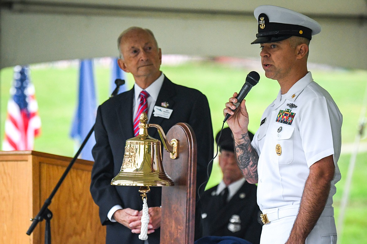 Master Chief Timothy Baldwin, right, and Dr. Bill Whitsitt, Chairman of the U.S.S. Montana Committee, unveil the ship's bell that will be aboard the future U.S.S. Montana (SSN 794), a nuclear-powered fast attack submarine that will join the Navy fleet in 2022. (Casey Kreider/Daily Inter Lake)