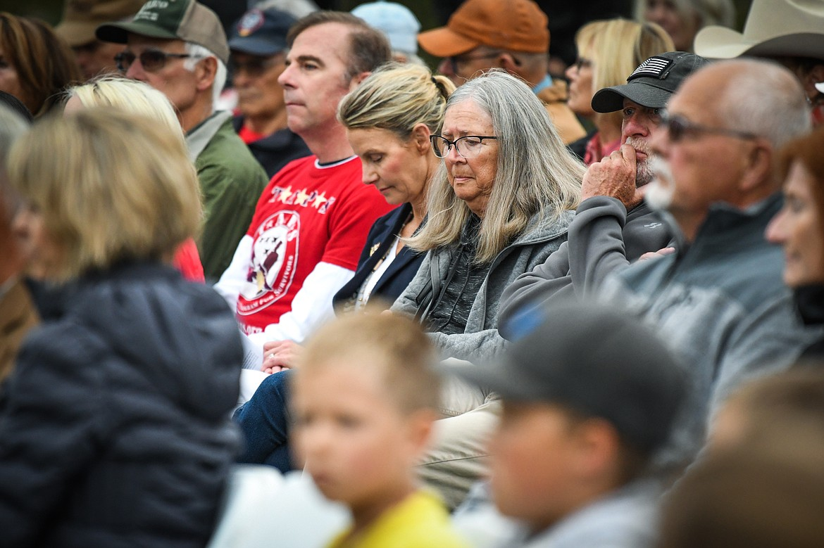 Attendees reflect as they listen to keynote speaker Micah Fink, CEO and founder of the Heroes and Horses non-profit organization and a former U.S. Navy Seal, at the 9/11 Honor & Serve Foundation's 20-year Remembrance Ceremony at Wrangler Springs Ranch in Bigfork on Saturday, Sept. 11, 2021. (Casey Kreider/Daily Inter Lake)