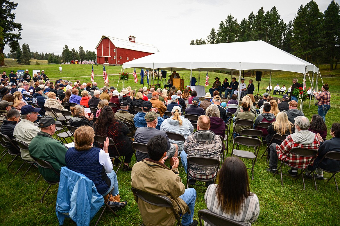 The crowd applauds a speaker at the 9/11 Honor & Serve Foundation's 20-year Remembrance Ceremony at Wrangler Springs Ranch in Bigfork on Saturday, Sept. 11, 2021. (Casey Kreider/Daily Inter Lake)