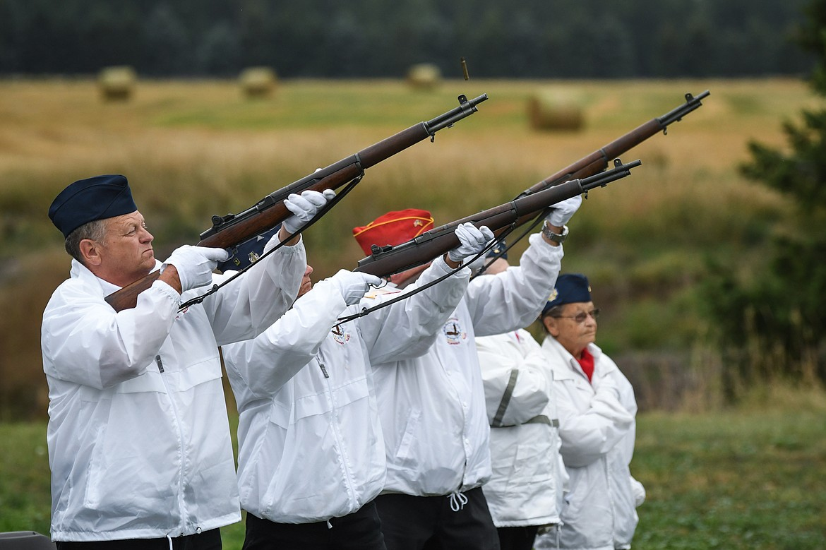 An honor guard and rifle team salutes during  the 9/11 Honor & Serve Foundation's 20-year Remembrance Ceremony at Wrangler Springs Ranch in Bigfork on Saturday, Sept. 11, 2021. (Casey Kreider/Daily Inter Lake)