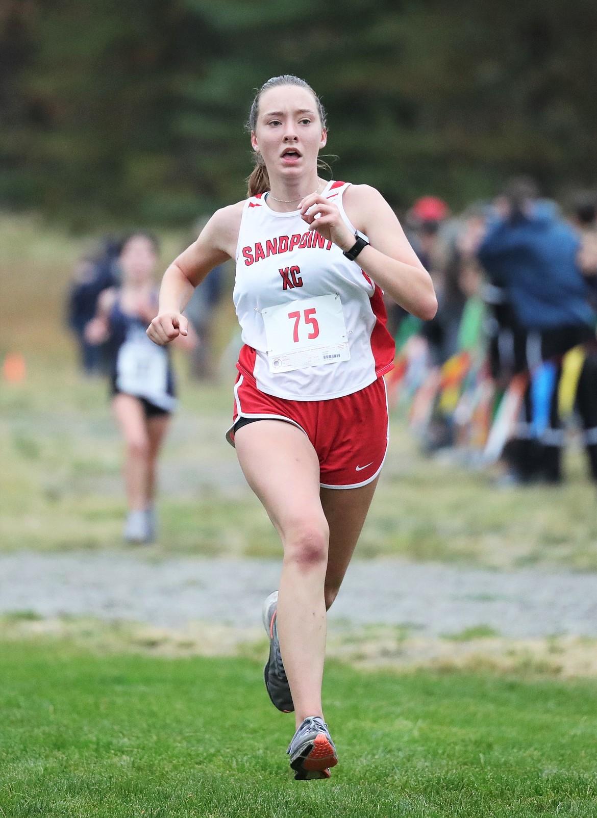Terra Bode nears the finish of the girls JV race.