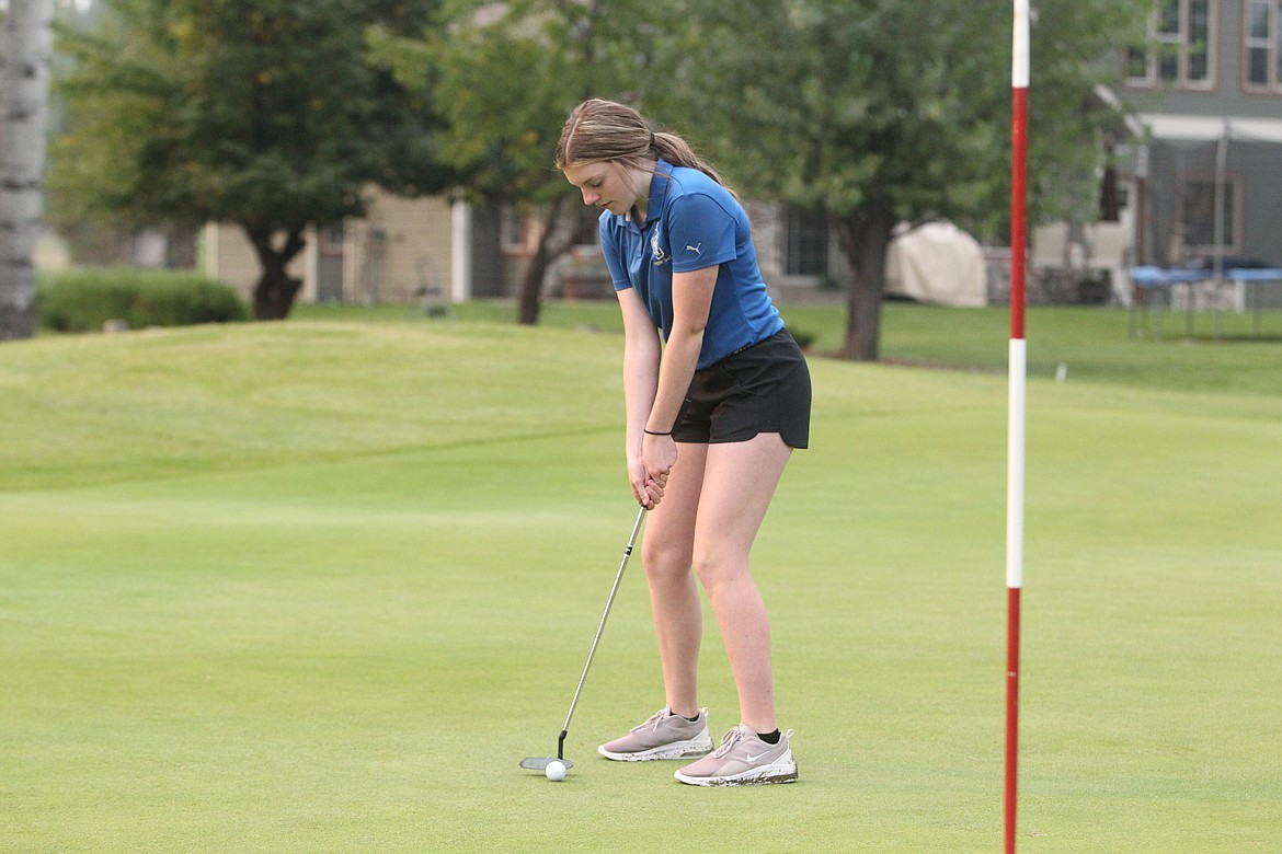 Allie Thorstenson prepares to putt during the Libby Golf Invitational on Sept. 10. (Will Langhorne/The Western News)