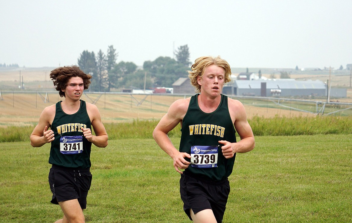 Whitefish seniors Zach Dunnagan, left, and Cole Cameron compete at the Flathead Invite in Kalispell. (Matt Weller photo)