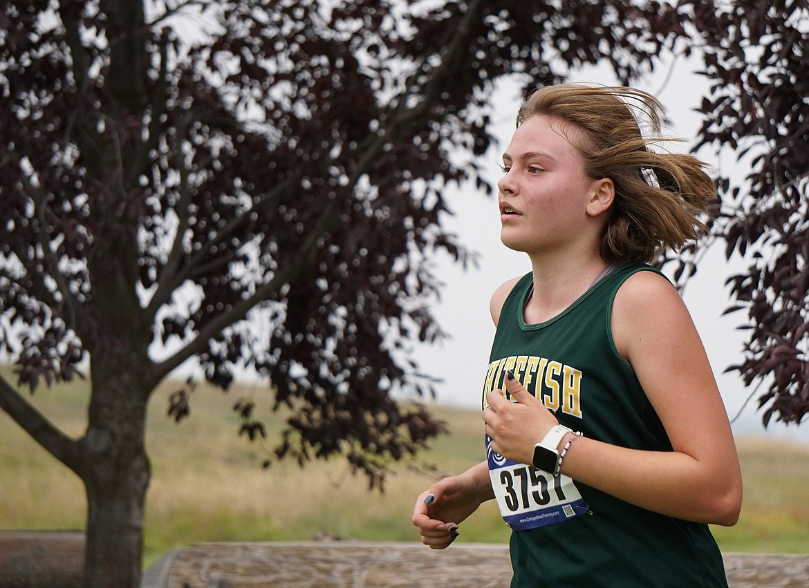 Whitefish freshman Charlotte Wallace placed fifth overall in women's junior varsity race with a time of 23.42 at the Flathead Invite in Kalispell Friday. (Matt Weller photo)